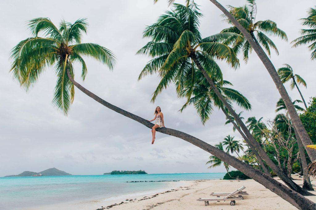 Holiday in Tahiti- Girl in palm tree in Bora Bora